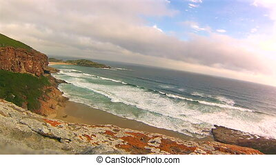Waves on the cliffs - View from the cliffs at sunset Robberg...