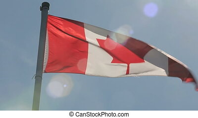 Canadian Flag Sun Lens Flare Zoom - Canadian flag waves in...