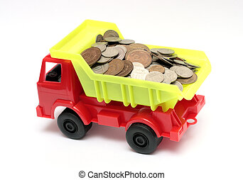 lorry with coins - business concept - toy lorry with coins -...