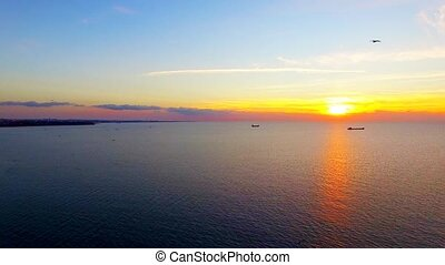 Birds Flying Over Sea At Sunset - AERIAL VIEW. Picturesque...