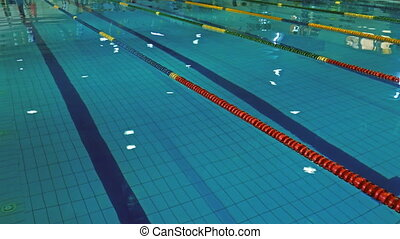 Overview of a swimming pool with marker control, before...