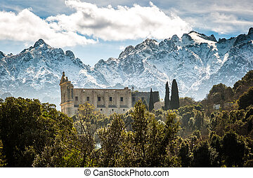 San Francesco convent and mountains at Castifao in Corsica -...