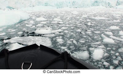 Ice and small icebergs floats on ocean surface - Ice and...