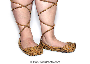peasant woman legs in russian bast shoes