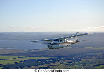 aloft at last - Single engined light aircraft flying over...