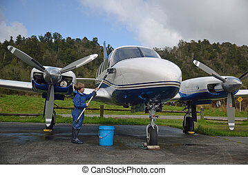 washing grandad's plane - 7-year-old boy washing his...