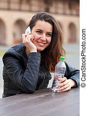 Happy young woman - Picture of a happy young woman talking...