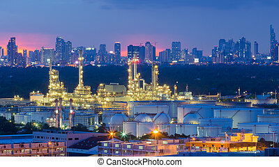 Refinery heavy industry with city background night time