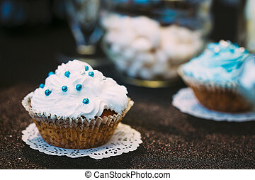 Dessert Sweet Tasty cupcake in Candy Bar On Table Delicious...
