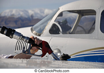 refuelling aeroplane - refilling the wing tanks on a twin...