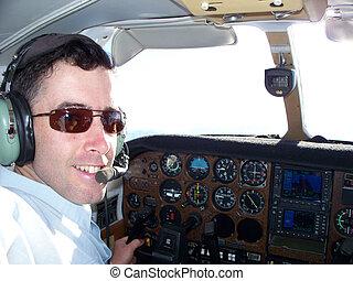 Pilot at controls of light aircraft