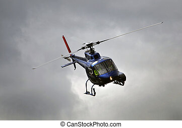 in control - chopper in flight, Westland, New Zealand