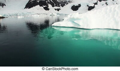 A small iceberg floating in waters of Antarctica Amazing...