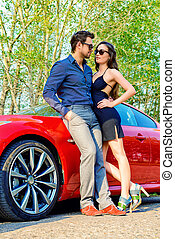 spending time together - Beautiful couple near the car...