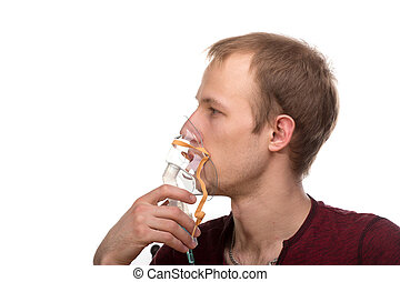 Man with inhaler - Young man using nebulizer mask for...