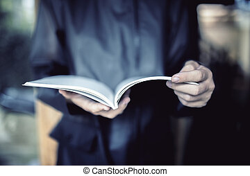 Girl in black coat with notepad