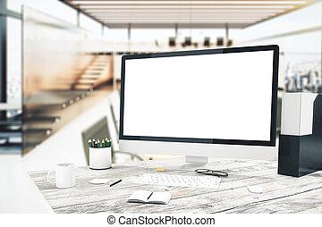 Blank monitor in sunlit office