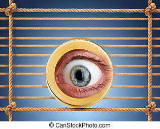 Human eye in the coin over rope net background