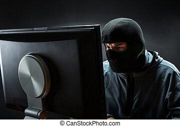 Hacker in the office - Hacker in mask is stealing...