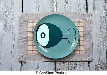 Empty plate with meat icon on light blue wooden background