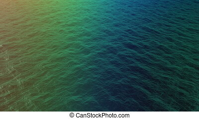 top view of multicolored water waves on sunset