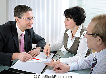 meeting - Senior couple meeting with financial planner or...