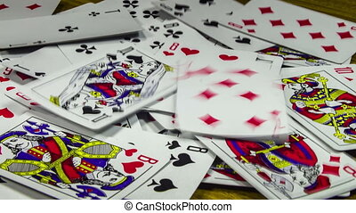 Playing Cards Moving and Rotate on a Wooden Table - Playing...