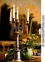 candlelight - a candlestand on the table in the old german...