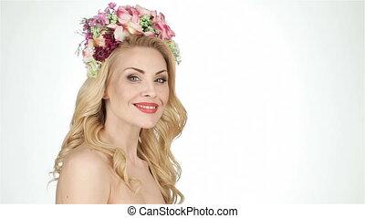 Portrait of a woman in a flower wreath