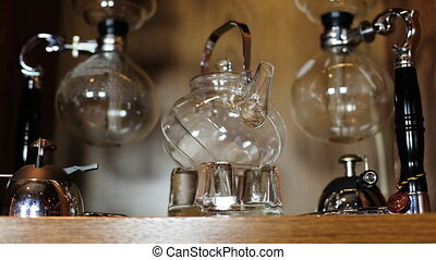 Glass empty teapot with metal handle with two Glass...