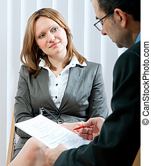 job interview - Young woman having a job interview in a...