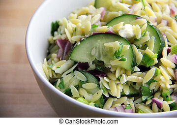 Orzo Salad - A bowl of homemade cucumber, onion and parsley...