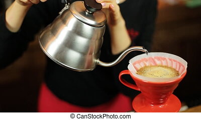 Pour over coffee brewing method whole process by barista...
