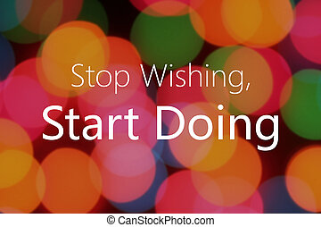 Stop wishing, start doing text on colorful bokeh background