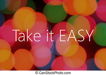 Take it easy text on colorful bokeh background