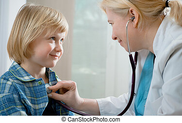 medical exam - female doctor examining little child boy