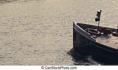 Canal Boat Passes At Sunset - Long boat goes past in calm...