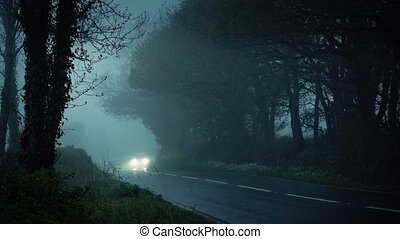 Car Drives In Misty Countryside - Off road vehicle driving...