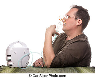 Adult man using inhalter indoors