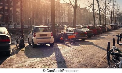 Car Passes Waterfront In The Sun - Car on road next to canal...
