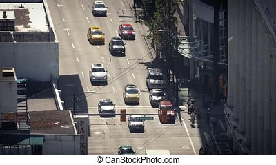 Cars And People On City Crosswalk