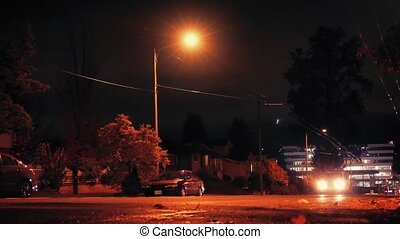 Cars Drive Past On City Road Night - Cars passing houses and...