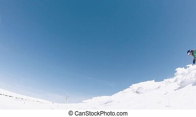 Snowboarder jumping - Snowboarder executing a radical jump...