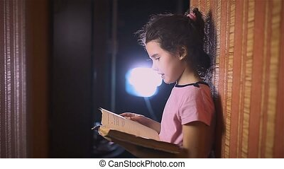 teen girl reading book is wall indoor - teen girl reading...