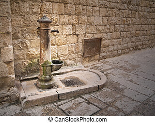 Rusty fountain in Oldtown of Molfetta Apulia