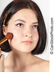 the girl does make-up