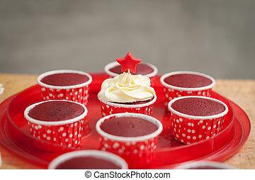 Making red velvet cupcakes - The action of making red velvet...