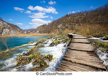 plitvice national park - Wooden pathway through the falls at...