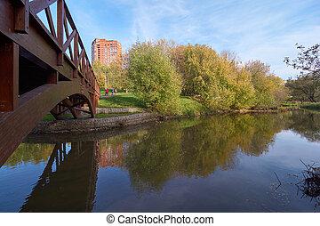 Wooden bridge across the river - New wooden bridge across...