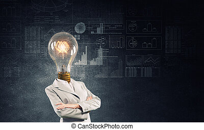 Her head full of great ideas - Businesswoman with light...